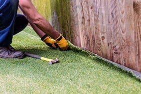 Should I Hire a Pro to Install Artificial Grass?