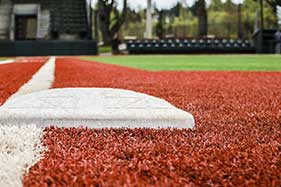 Is artificial grass is safer than a traditional field?